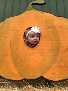 baby in photo pumpkin